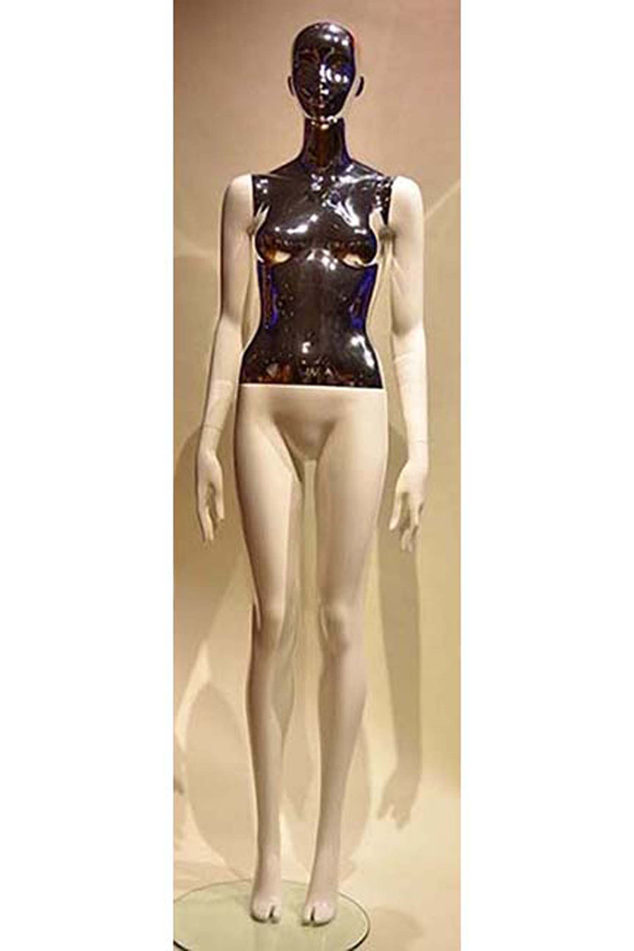 female mannequin with glossy white arms and legs, silver chrome torso and head, arms at sides, and legs together