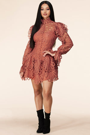 This Intricately designed crochet lace mini dress