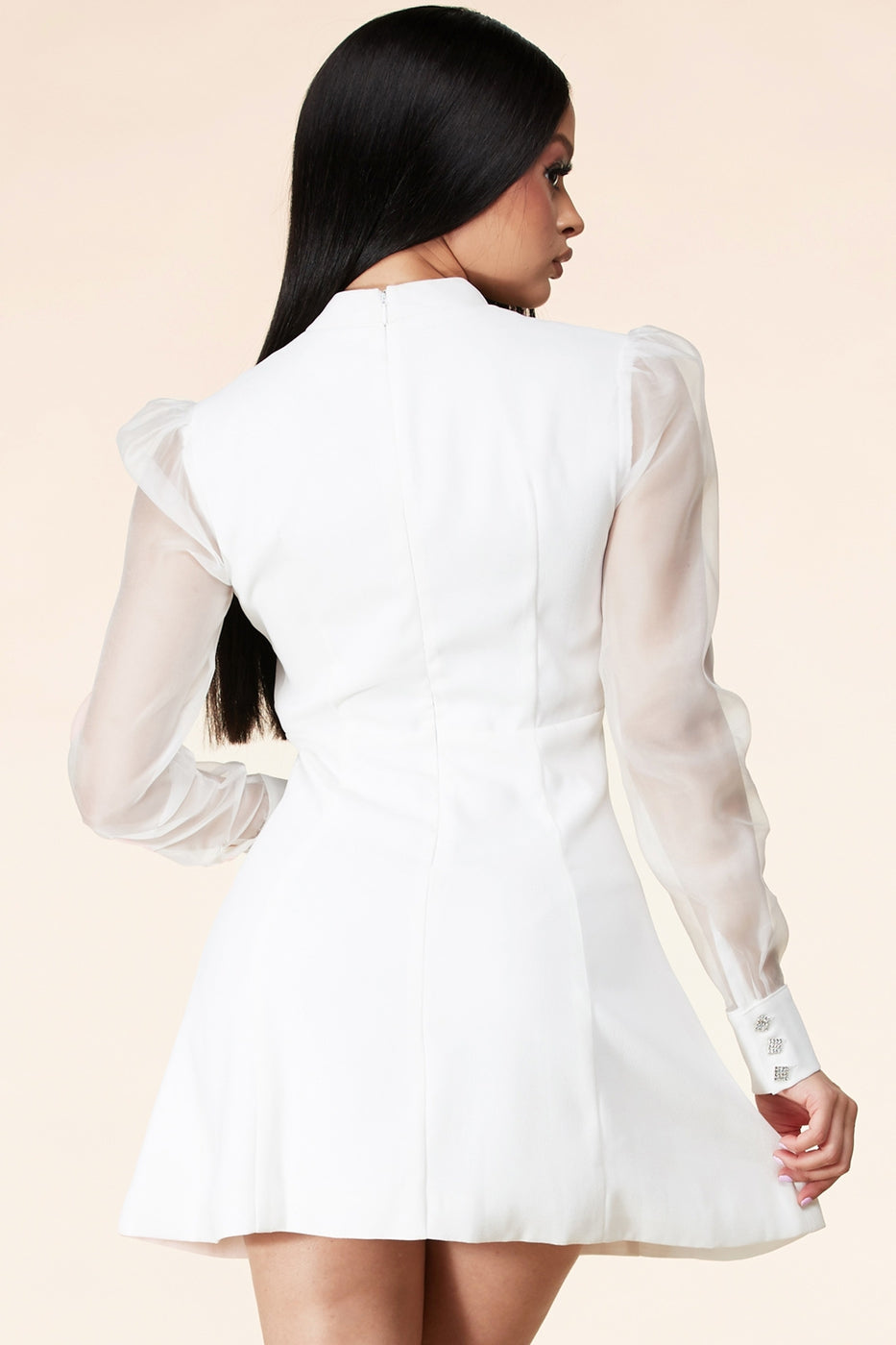 White mini dress with contrast mesh sleeves