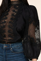 Intricate crochet pattern contrast woven top