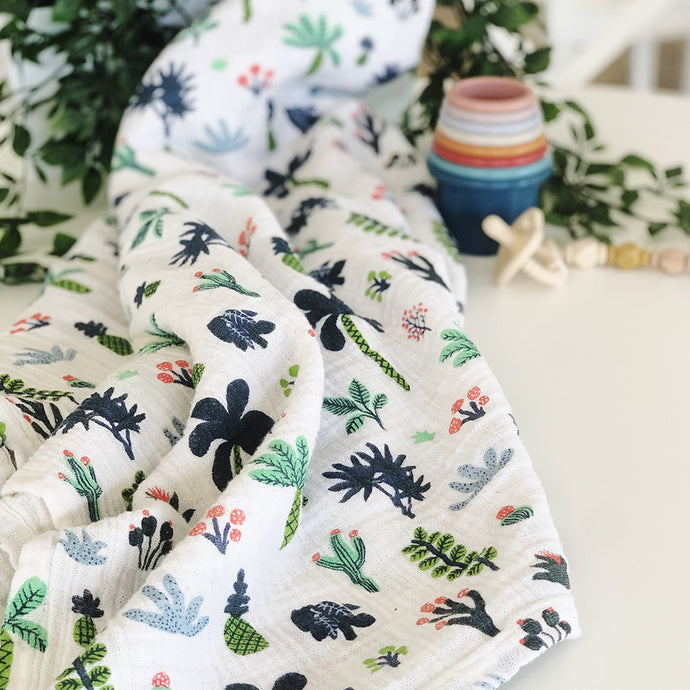 Pick a Nursery Theme Using Your Favorite Swaddle Like This...