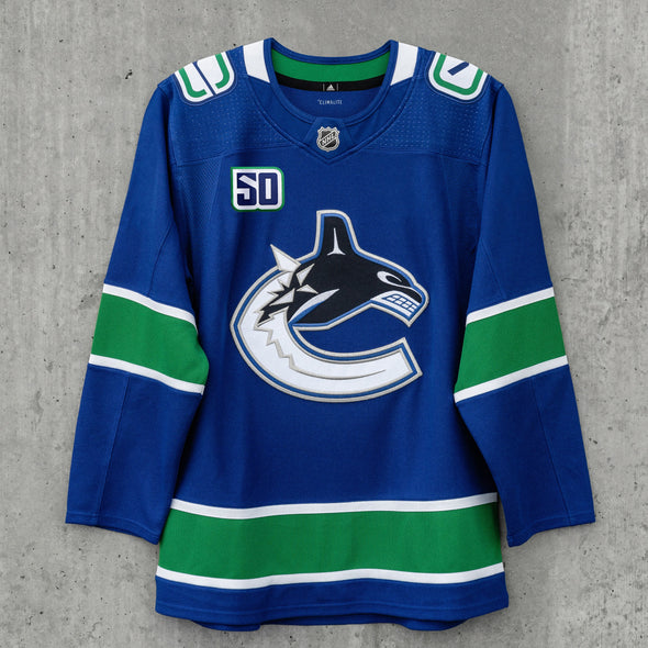 Elias Pettersson Signed Home Jersey