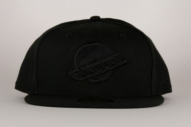 Vancouver Canucks New Era Tonal Black Skate 5950 Hat