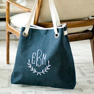Ellis Hill Grommet Tote, in textured linen or plastic-coated cotton, with monogram, measures 17W by 18T