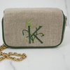 Ellis Hill Kris Case, in linen or plastic-coated cotton, with monogram, 11 in. by 9.5 in.