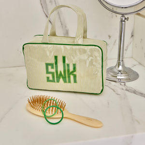Medium Handled Cosmetic Case, in linen or plastic-coated cotton, custom monogram, 11 in. by 7 in.