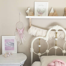 Wreath with wild flowers and pink angel wing displayed in sweet girls bedroom. Scandi decor inspiration with hand made products from Instagram. Watercolour paintings from Australian artist.