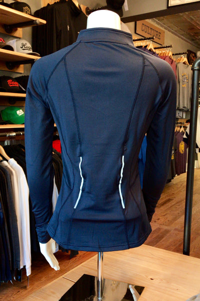 The Minnesotan Women's Navy Elite 1/2 Zip by UNRL