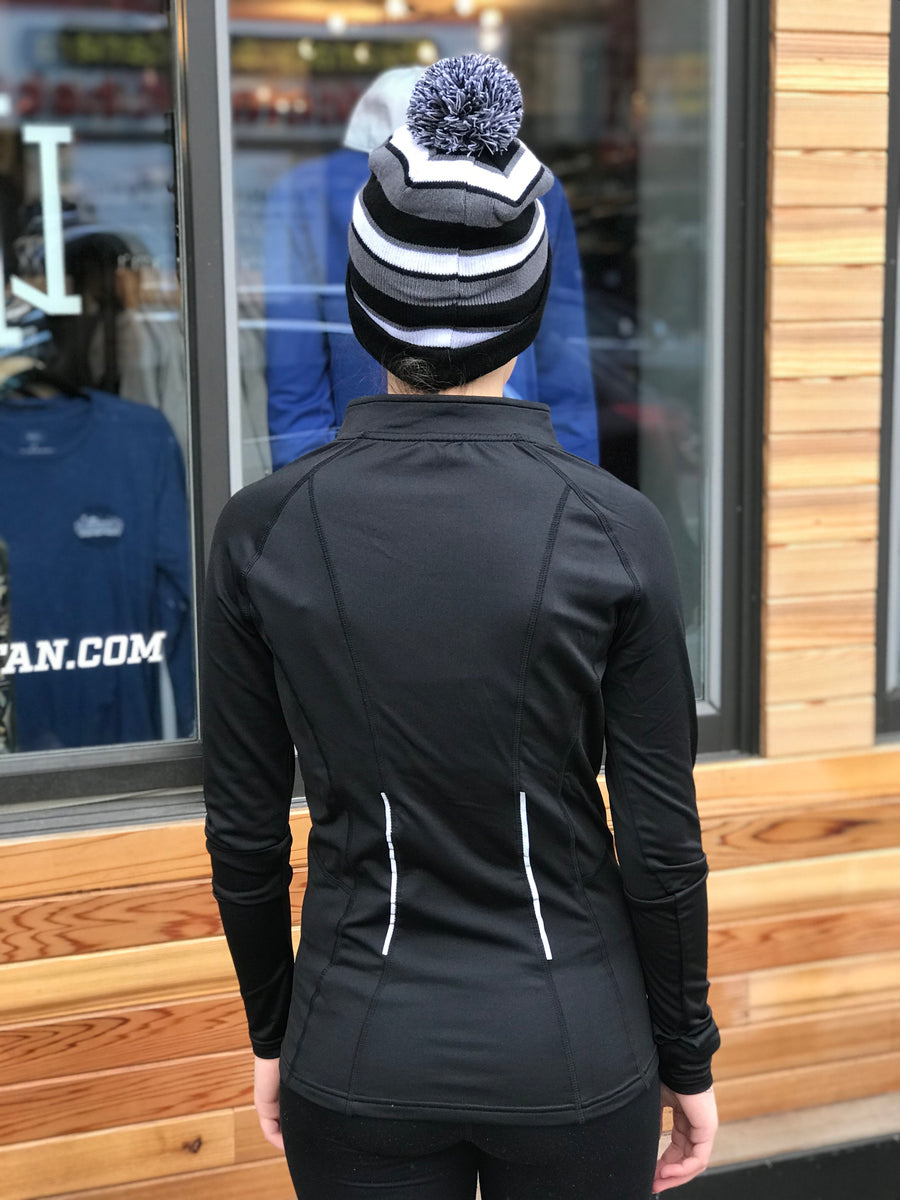 The Minnesotan Women's Black Elite 1/2 Zip by UNRL