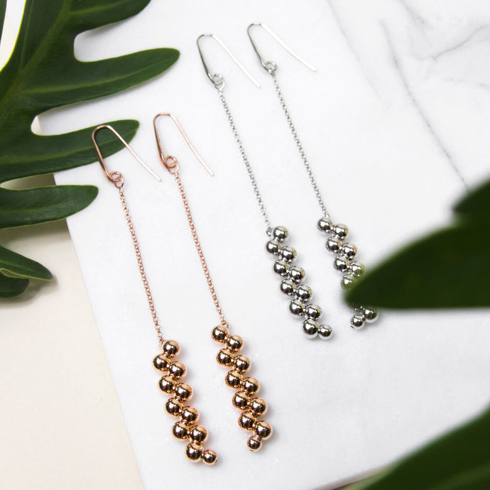 long drop chain earrings with cascading balls design