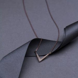 short chain necklace with v shaped motif