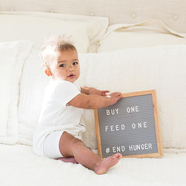 Baby Holding Letterboard