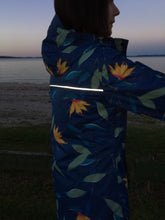 Load image into Gallery viewer, Scribbler waterproof ladies womens women's raincoat rain jacket blue denim floral strelitzia bird of paradise colourful NZ New Zealand reflective strip