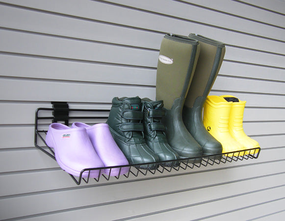 Angled Shoe Shelf securely holding walking boots and Wellies
