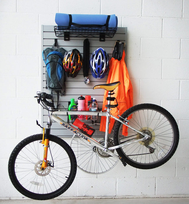 Wall mounted Bike Storage Kit securely holding a bike as well as bike accessories and apparel such as helmets, coats and water bottles