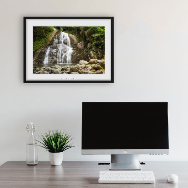 vermont waterfall print hanging above a computer