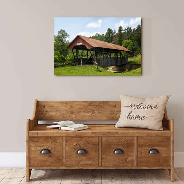 covered bridge canvas wall art hanging over a farmhouse bench