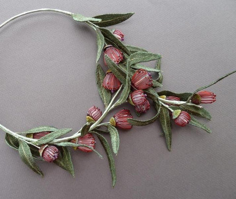 Eucalyptus Blossom necklace made by Suzette Watkins.  Glass flower beads by Bev Butler, leaves and caps by Lynne Stone