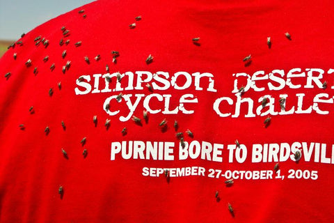 Photo of flies on a red T-shirt, Simpson Desert Cycle Challenge, taken by Mike Fewster.