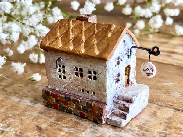 "Lovely one-of-a- kind handmade clay house from ""Casetta"" - Cafe Brown"