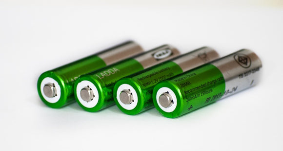 4 green and silver batteries