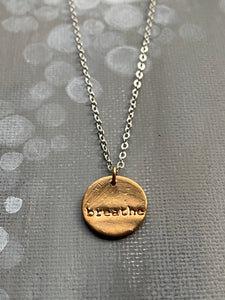 Breathe Hand Stamped on Circle Bronze Charm Necklace