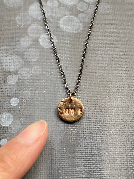 Love Hand Stamped on Circle Bronze Charm Necklace