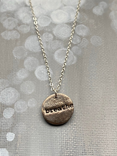 Breathe Hand Stamped on Circle Steel Charm Necklace