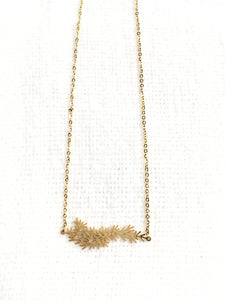 Evergreen branch pendant necklace gold stainless steel