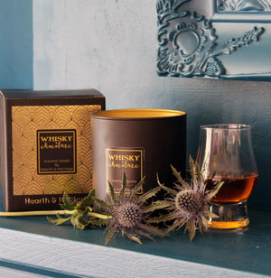Chocolate and Whiskey Scented Candle in Black and Gold Glass.