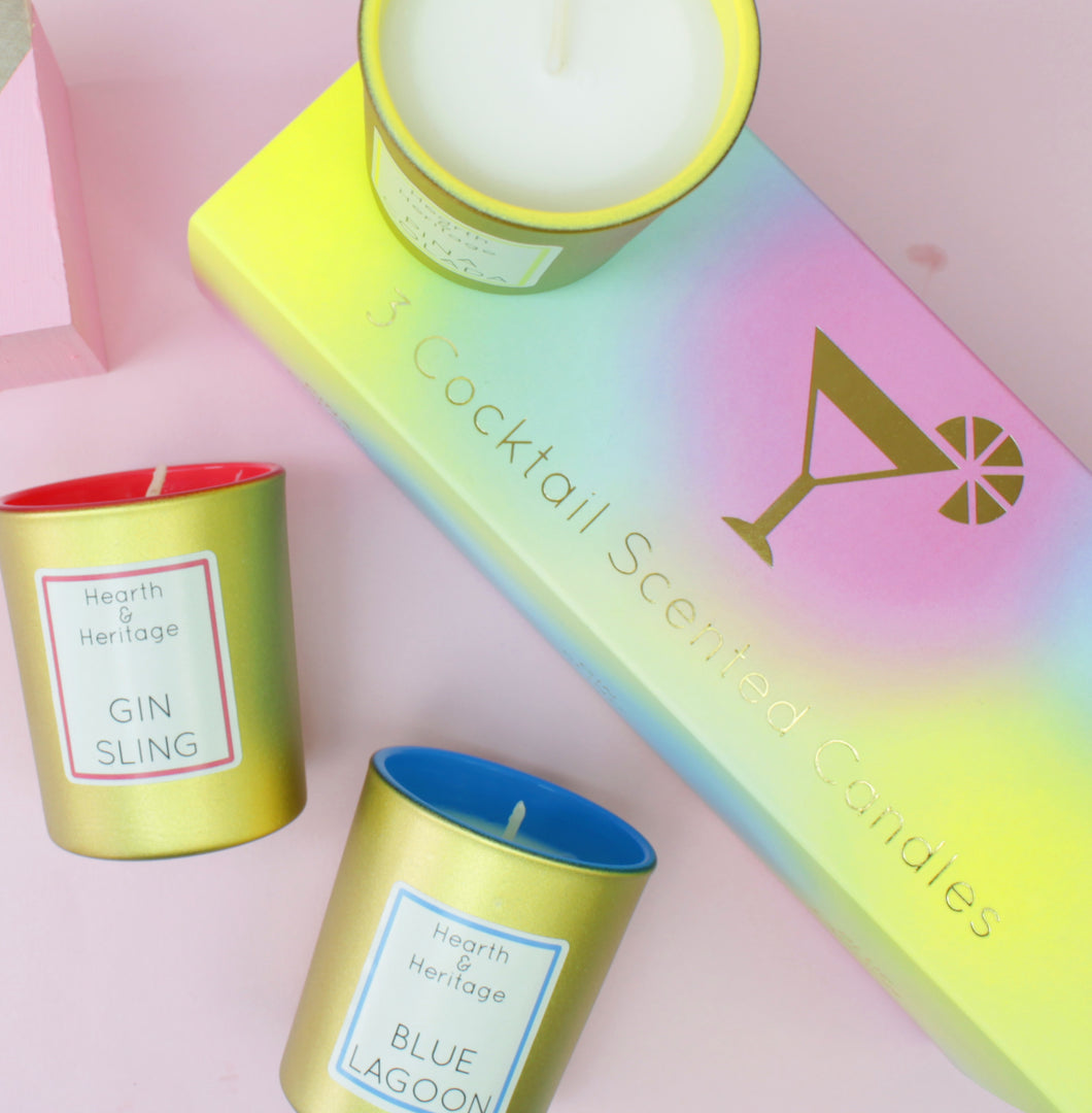 A Set of 3 Cocktail Scented Candles in gold glasses and cocktail gift box