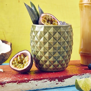 Ceramic cocktail jars in pineapple and coconut designs.