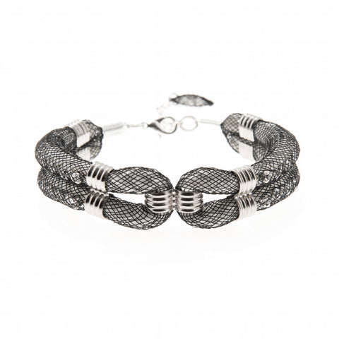 This silver plated woven mesh bracelet called 'Clove Cuff' is the perfect addition to the wardrobe. Its contemporary design is easy to wear at any age and is made with a 3cm extension chain