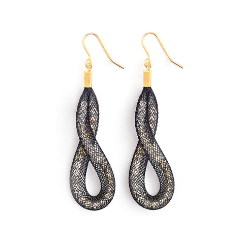 The Loop & Twist earrings are  grand in gesture and uniquely shaped.