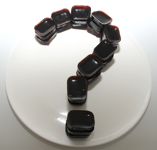Gelatin cherry gummies arranged in a question mark