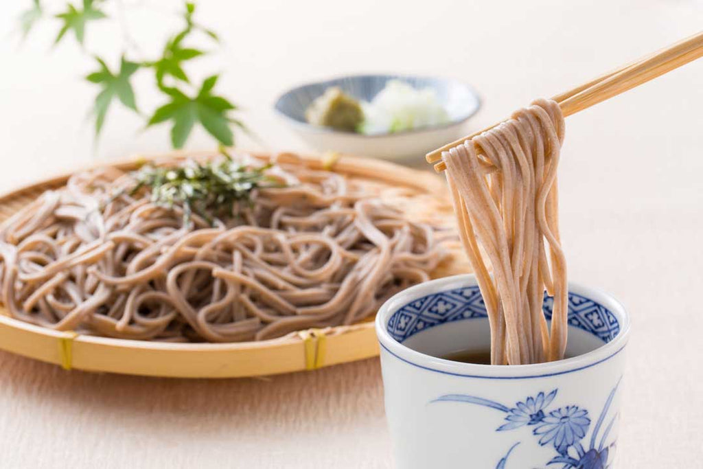 Soba noodles being dipped in sauce