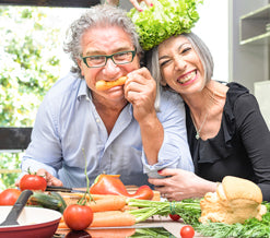 mature couple eating vegetables