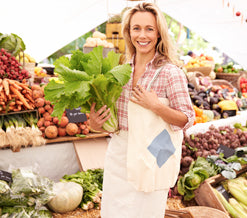 smiling blonde woman at a farmers market