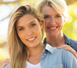 older mother and daughter smiling potrait