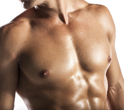 man with gleaming abs and chest