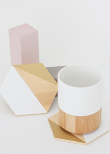 Hand-painted set of 4 Coasters that together make a geometric trivet for your modern table. Stoneware mug available.