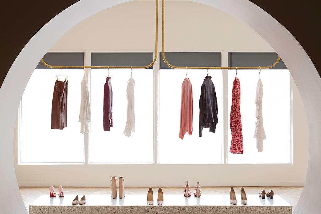 The So Over It Studio archway which opens to clothing on racks