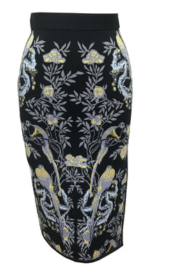 Anna Bird Jacquard Skirt in Black - VIAVAI FASHION  Photograph of a pencil skirt in black color with a bird , floral, and fruit pattern  in grey, yellow, blue and purple colors. photo of the front view .