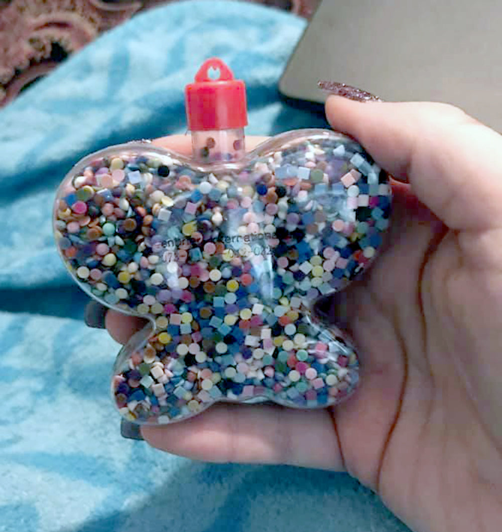 Butterfly Container Filled With Leftover Gems
