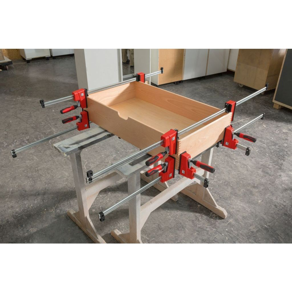 Slide the fixed head of the Bessey K Body VARIO REVOlution 1700 Pound Parallel Bar Clamp to make the clamp more balanced over the workpiece and easier to maneouver