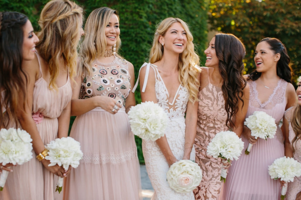 bride and bridal party on the day of wedding wearing hair extensions