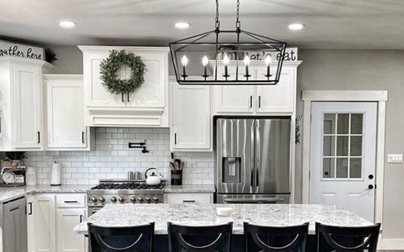 White Farmhouse Kitchen with signs above cabinets