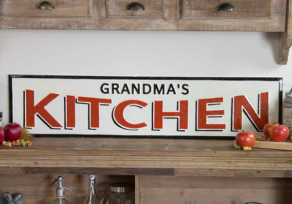 Large Grandmas Kitchen Sign with white background red and black letters