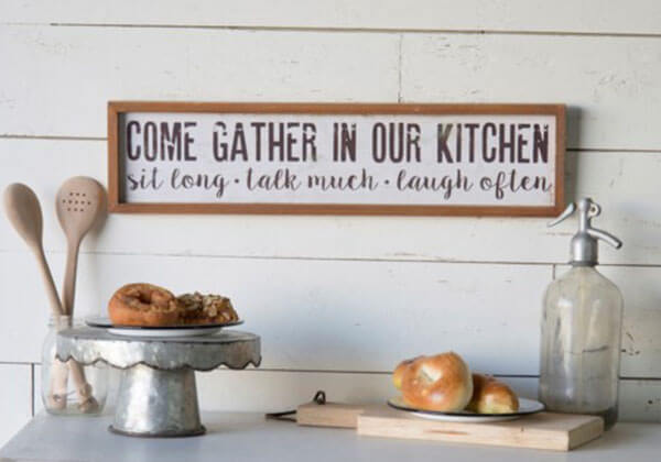 "Wood framed ""Gather in our Kitchen"" sign"
