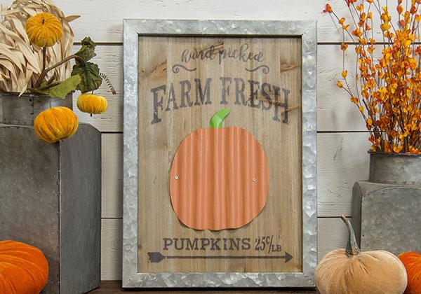 wood and metal farm fresh pumpkins sign